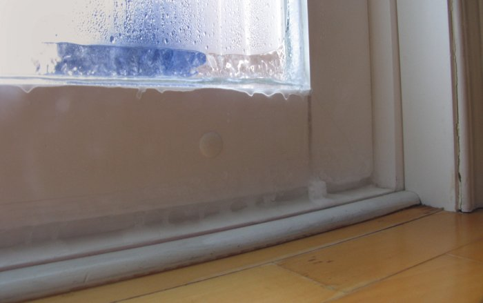 Ice buildup on patio door due to condensation - hard wood floor damage