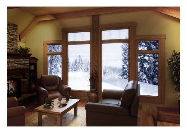 Side casement windows with center & top picture windows in den