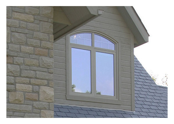 Shaped windows over 1 fixed picture window and 1 casement window