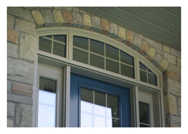 Custom shaped vinyl transom windows over entrance way