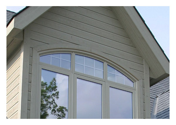 Shaped windows, casement and picture windows in dormer