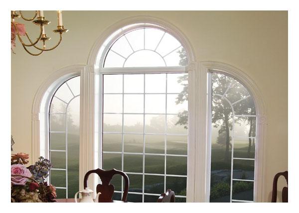 Shaped vinyl palladian window in formal dinning room
