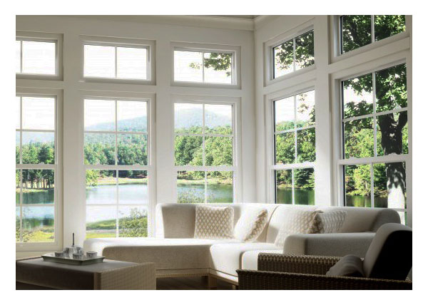 Traditional styling of single hung and picture windows in sun room