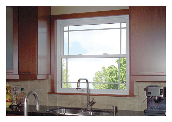 Single hung windows with prairie style grills